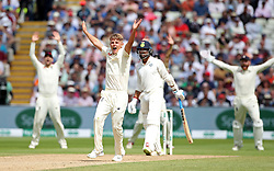 England's Sam Curran appeals for the LBW of India's Murali Vijay, which is given, during day two of the Specsavers First Test match at Edgbaston, Birmingham.