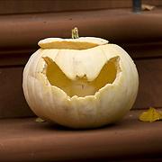 Halloween ba pumpkin decorations in Greenwich Village. Carved pumpkin on door steps made into Jack-0'-Lantern.