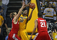 January 27, 2010: Iowa forward Jarryd Cole (50) puts up a shot as Ohio State center Kyle Madsen (15) defends during the first half of their game at Carver-Hawkeye Arena in Iowa City, Iowa on January 27, 2010. Ohio State defeated Iowa 65-57.