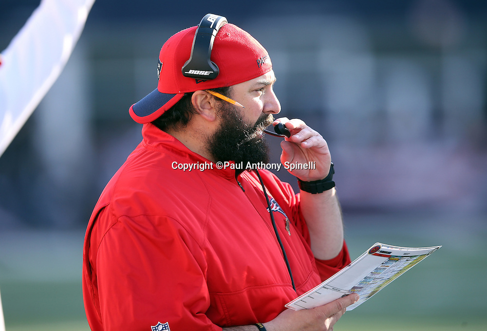 New England Patriots defensive coordinator Matt Patricia talks on his headsets on the sideline during the 2015 week 9 regular season NFL football game against the Washington Redskins on Sunday, Nov. 8, 2015 in Foxborough, Mass. The Patriots won the game 27-10. (©Paul Anthony Spinelli)