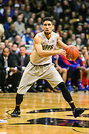 December 7th, 2013:  Colorado Buffaloes junior guard Askia Booker (0) controls the action during the second half of the NCAA Basketball game between the Kansas Jayhawks and the University of Colorado Buffaloes at the Coors Events Center in Boulder, Colorado