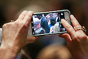 A supporter takes a camera phone photo of Former Secretary of State and Democratic presidential candidate Hillary Rodham Clinton during a campaign event at Trident Tech June 17, 2015 in North Charleston, South Carolina.