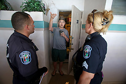 Hollywood Police officer Kenny Klingman and Sgt. Gina Aud speak to a resident at the Seahorse Condominium on Hollywood Beach about evacuating.  The man who did not want to give his name said he was undecided about evacuating from his ocean front condo.  The Hollywood police are creating lists of residents who have decided to remain on the beach even though its a mandatory evacuation zone.  Hollywood police say they will check on those known individual after the storm passes.   (Susan Stocker/Sun Sentinel/TNS/Sipa USA)<br />SOUTH FLORIDA OUT; NO MAGS; NO SALES; NO INTERNET; NO TV