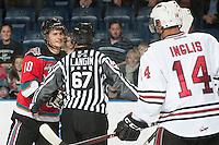 KELOWNA, CANADA - NOVEMBER 9:  Filip Vasko #10 of the Kelowna Rockets is separated from the Red Deer Rebels by linesman Mike Langin at the Kelowna Rockets on November 9, 2012 at Prospera Place in Kelowna, British Columbia, Canada (Photo by Marissa Baecker/Shoot the Breeze) *** Local Caption ***
