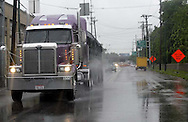 An 18 wheeler makes its way south on Keowee into downtown Dayton in the rain, Wednesday, June 4, 2008.