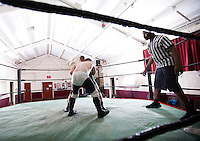 Full-length of wrestlers fighting in ring