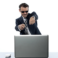 one caucasian criminal man hacker computer happy computing laptop  in studio isolated on white background