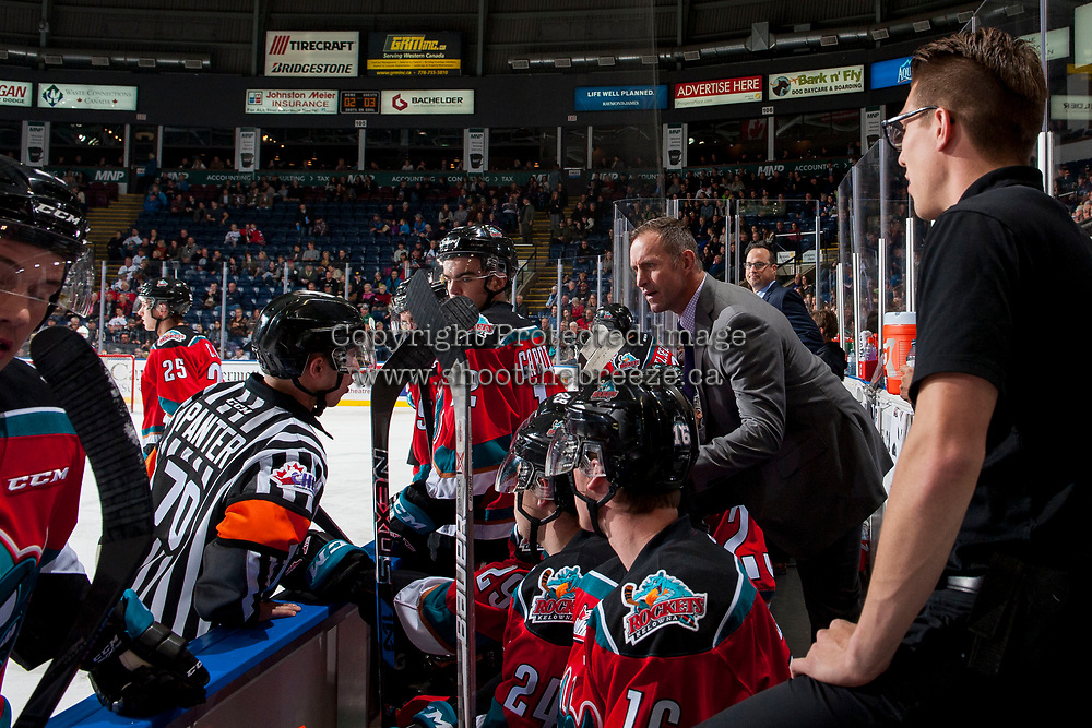 KELOWNA, CANADA - OCTOBER 13: Kelowna Rockets' head coach Jason Smith stands on the bench and speaks to referee Nick Panter during first period against the Calgary Hitmen on October 13, 2017 at Prospera Place in Kelowna, British Columbia, Canada.  (Photo by Marissa Baecker/Shoot the Breeze)  *** Local Caption ***