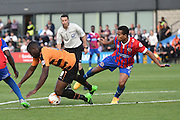 John Akinde of Barnet brought down just outside the penalty area by Joe Widdowson of Dagenham and Redbridge  of Dagenham and Redbridge  during the Sky Bet League 2 match between Barnet and Dagenham and Redbridge at Hive Stadium, London, England on 26 September 2015. Photo by Ian Lyall.
