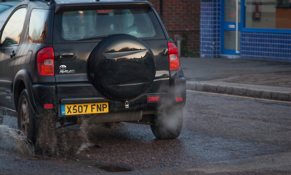 exhaust fumes rise from vehicles in Berkhamsted, England Tuesday, April 5, 2016 . (Elizabeth Dalziel for Greenpeace )