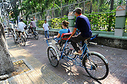 Tourist riding in a Cyclo (bicycle rickshaw), Ho Chi Minh City (Saigon), Vietnam