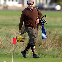 The PGA World Hickory Golf Open is being held at Gullane Golf Club on Thursday and Friday, 24th and 25th September 2009 featuring professional golf champions and amateurs in traditional 1930s period costume with six pre-1936 hickory shafted clubs in pencil golf bags...Picture shows German hickory golfer Markus Kuemmrle on the practice putting greens before teeing off.