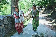 Kinnauri ladies with their dog at Chinni village, Kalpa, Kinnaur