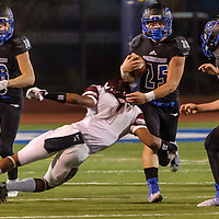 Friendswood #25 Sam Longbotham tries to break away from Clear Creek #1 Colby Burton during the game at Winston Stadium in Friendswood 10/17/14
