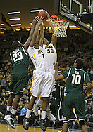 February 2 2011: Michigan State Spartans forward Draymond Green (23), Iowa Hawkeyes forward Melsahn Basabe (1), and Iowa Hawkeyes forward Jarryd Cole (50) during the first half of an NCAA college basketball game at Carver-Hawkeye Arena in Iowa City, Iowa on February 2, 2011. Iowa defeated Michigan State 72-52.