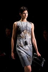 © London News PIctures. 13/09/2013. London, UK.  A model walks the catwalk at Christopher Raeburn catwalk show at London Fashion Week Spring/Summer 2014. Photo credit: Ben Cawthra/LNP