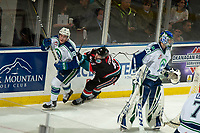 KELOWNA, CANADA - OCTOBER 23:  Jack Cowell #8 of the Kelowna Rockets back checks Ethan Regnier #18 of the Swift Current Broncos during third period on October 23, 2018 at Prospera Place in Kelowna, British Columbia, Canada.  (Photo by Marissa Baecker/Shoot the Breeze)