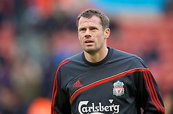 STOKE, ENGLAND - Saturday, January 16, 2010: Liverpool's Jamie Carragher warms-up before the Premiership match against Stoke City at the Britannia Stadium. (Photo by David Rawcliffe/Propaganda)