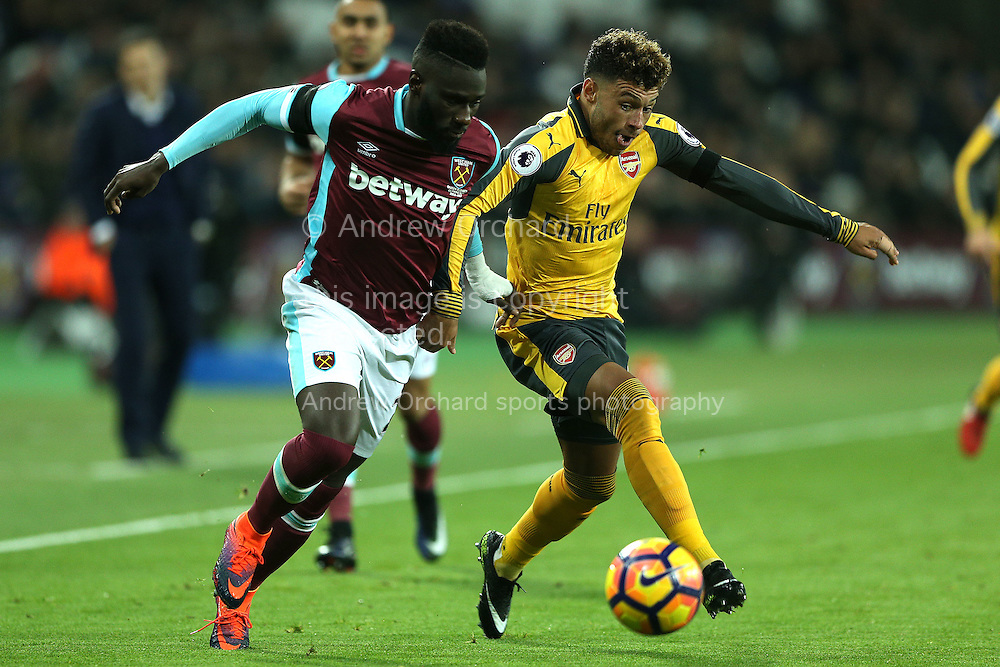 Alex Oxlade-Chamberlain of Arsenal (r) and Arthur Masuaku of West Ham United compete for the ball. Premier league match, West Ham Utd v Arsenal at the London Stadium, Queen Elizabeth Olympic Park in London on Saturday 3rd December 2016.<br /> pic by John Patrick Fletcher, Andrew Orchard sports photography.