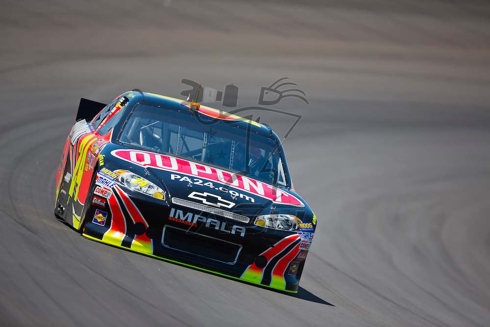 BROOKLYN, MI - JUN 14, 2012:  Jeff Gordon (24) brings his car through the turns during the second test session for the Quicken Loans 400 at the Michigan International Speedway in Brooklyn, MI.