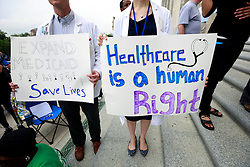 30 April 2013. Baton Rouge, Louisiana,  USA. .March on Baton Rouge, Enough is Enough. A coalition of 40 Louisiana Organisations protest what many believe to be the 'Economic and fiscal disaster that is the administration of Governor Bobby Jindal.' Top of the agenda,  Jindal's refusal to accept the expansion of MEDICAID, instead denying coverage to over 400,000 citizens with Jindal refusing to accept federal funding for  'Obamacare.' Slashed state spending on education, social services and critical community based organisations is having far reaching and devastating effects on ordinary and poor citizens in Louisiana..Photo; Charlie Varley.