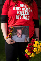 © Licensed to London News Pictures. 12/04/2016. London, UK. SARAH DORRICOTT holds a picture of their father Mike Dorricott who died after being given blood infected with Hepatitis C. Campaigners and victims of contaminated blood gather outside the Houses of Parliament in London on the day that the House of Commons will debate government plans to reform payouts to people infected by contaminated blood. The blood scandal saw some 6,000 people, many with the blood disorder haemophilia, infected with HIV and hepatitis C by infected blood products used by the NHS up until 1991.Photo credit: Ben Cawthra/LNP