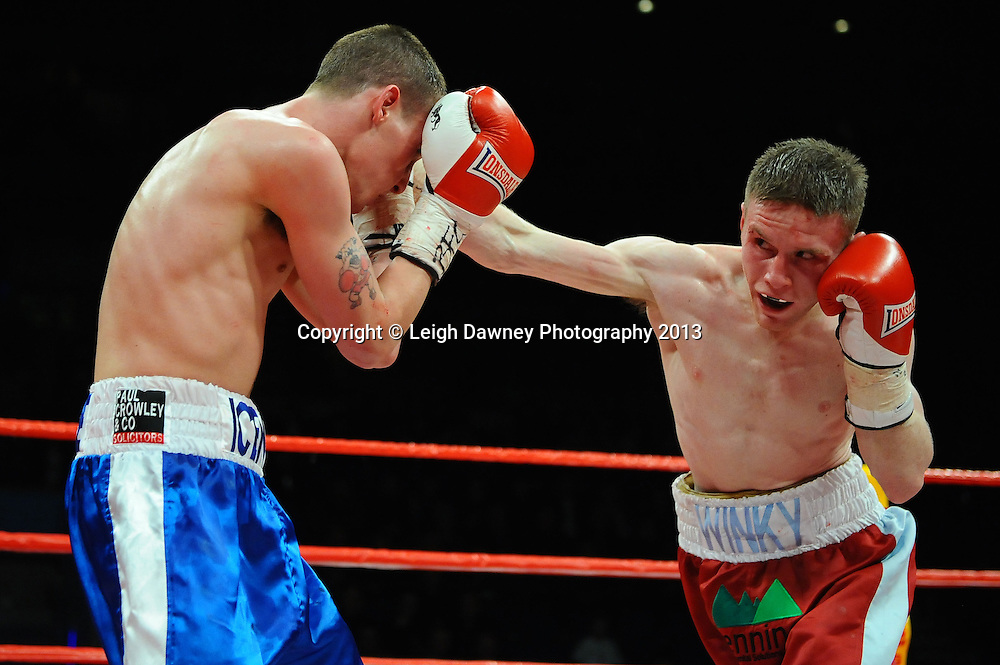 Kevin Satchell defeats Luke Wilton in a 12x3 round bout for the British Flyweight Title at the Echo Arena, Liverpool, United Kingdom on the 23rd February 2013. Frank Maloney Promotions. © Leigh Dawney Photography 2013