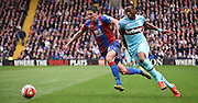 Martin Kelly and Diafra Sakho chase down the loose ball during the Barclays Premier League match between Crystal Palace and West Ham United at Selhurst Park, London, England on 17 October 2015. Photo by Michael Hulf.