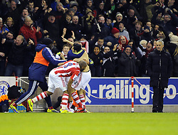 Stoke City's Oussama Assaidi celebrates his winning goal with team mates in front of a dejected Chelsea Manager, Jose Mourinho - Photo mandatory by-line: Joe Meredith/JMP - Tel: Mobile: 07966 386802 07/12/2013 - SPORT - Football - Stoke-On-Trent - Britannia Stadium - Stoke City v Chelsea - Barclays Premier League