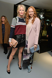 Left to right, CAROLINE WINBERG and LILY COLE at the Louis Vuitton Series 3 VIP Launch held at 180 Strand, London on 20th September 2015.