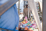 "1 July 2009, Sudanese ""Lost Boy"" Aher Arop Bol at his spaza shop in Wonderboom, Pretoria and at the home of Sannie Meiring where he boards. He was born in a Dinka village in the Bahr el Ghazal region of Southern Sudan.  Bol now lives in Pretoria. He runs a spaza shop which enables him to pay his UNISA fees (he is studying law) and maintain his two brothers, with whom he has been reunited, at a boarding school in Uganda. Bol actively identifies himself as a ""lost boy"", one of the tens of thousands of Sudanese children who were forced to leave their homeland because of their country's civil war."