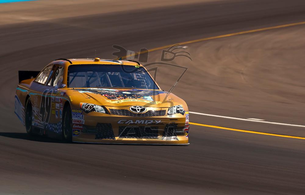 AVONDALE, AZ - MAR 03, 2012:  J.J. Yeley (49) brings his NASCAR Sprint Cup car through turn 4 during qualifying for the Subway Fresh Fit 500 race at the Phoenix International Raceway in Avondale, AZ.