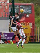 12th August 2017, SuperSeal Stadium, Hamilton, Scotland; SL Football league Hamilton Academicals versus Dundee; Dundee's Jack Hendry heads clear from Hamilton's Rakish Bingham