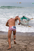 Swimmer Heading out at the Dory Boat Races Event in San Clemente