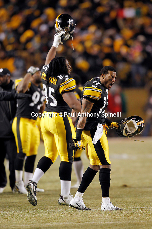 Pittsburgh Steelers wide receiver Mike Wallace (17) yells in celebration as Pittsburgh Steelers tight end David Johnson (85) raises his helmet after winning the NFL 2011 AFC Championship playoff football game against the New York Jets on Sunday, January 23, 2011 in Pittsburgh, Pennsylvania. The Steelers won the game 24-19. (©Paul Anthony Spinelli)