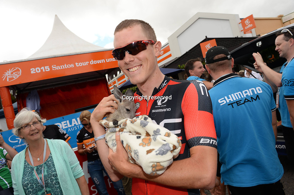 21.01.2015. Unley to Stirling. Tour Down Under cycling tour.  Bmc 2015, Dennis Rohan holds a baby kangaroo in Unley