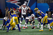 New England Patriots quarterback Tom Brady (12) points to his helmet while calling a play in a shotgun formation during the NFL Super Bowl 53 football game against the Los Angeles Rams on Sunday, Feb. 3, 2019, in Atlanta. The Patriots defeated the Rams 13-3. (©Paul Anthony Spinelli)