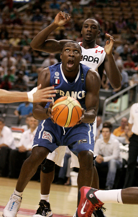 GJR511.jpg -20100813- Toronto, Ontario,Canada<br /> France's Florent Pietrus controls the ball during the second meeting between Canada and France at the 2010 Jack Donohue International Classic basketball tournament in Toronto, Canada August 13, 2010<br /> AFP PHOTO/Geoff Robins