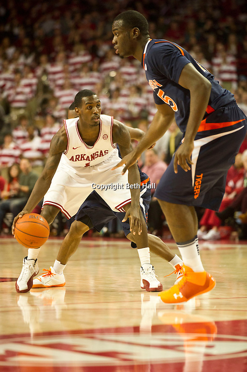 Jan 25, 2012; Fayetteville, AR, USA; Arkansas Razorbacks guard Mardracus Wade (1) dribbles the ball against Auburn Tigers forward Adrian Forbes (45) during a game at Bud Walton Arena. Arkansas defeated Auburn 56-53. Mandatory Credit: Beth Hall-US PRESSWIRE