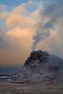 Steam venting from White Dome Geyser and autumn storm clouds at sunrise, Yellowstone National Park, Wyoming
