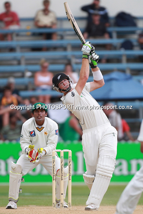 Martin Guptill hits out as Pakistan wicketkeeper Adan Akmal looks on during Day 4 of the 2nd test match.  New Zealand Black Caps v Pakistan, Test Match Cricket. Basin Reserve, Wellington, New Zealand. Tuesday 18 January 2011. Photo: Andrew Cornaga/photosport.co.nz