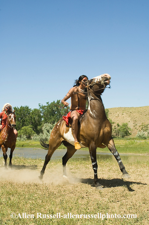 Custers Last Stand Reenactment. Crow Indian Reservation on Little Bighorn River. Warriors ride from camp to defeat Custer and 7th Cavalry