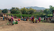 Women rinsing themselves after service in Ghusiya Ryt., Madhya Pradesh, india