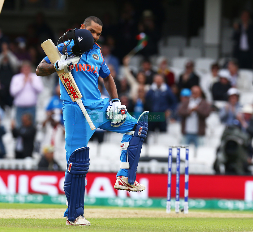 June 8, 2017 - London, United Kingdom - Shikhar Dhawan of India celebrates his centuryduring the ICC Champions Trophy match Group B between India and Sri Lanka at The Oval in London on June 08, 2017  (Credit Image: © Kieran Galvin/NurPhoto via ZUMA Press)