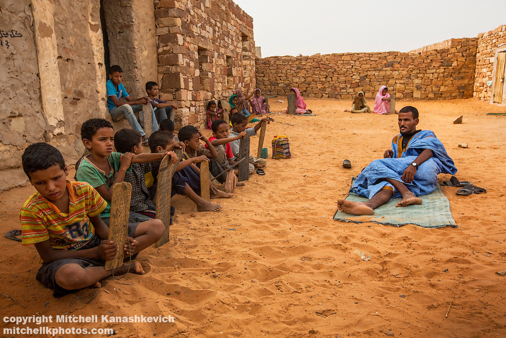 Mauritanian children learning the quaran in an Islamic school called a mahadara. Adrar, Mauritania