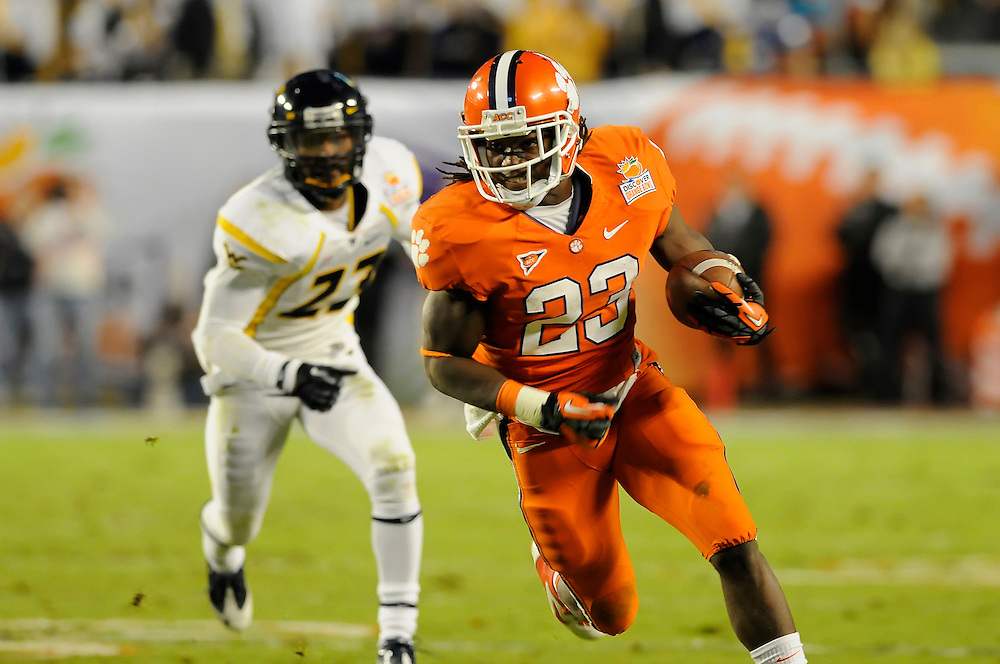 January 4, 2012: Andre Ellington #23 of Clemson runs past Brodrick Jenkins #23 of West Virginia during the NCAA football game between the West Virginia Mountaineers and the Clemson Tigers at the 2012 Discover Orange Bowl at Sun Life Stadium in Miami Gardens, Florida.