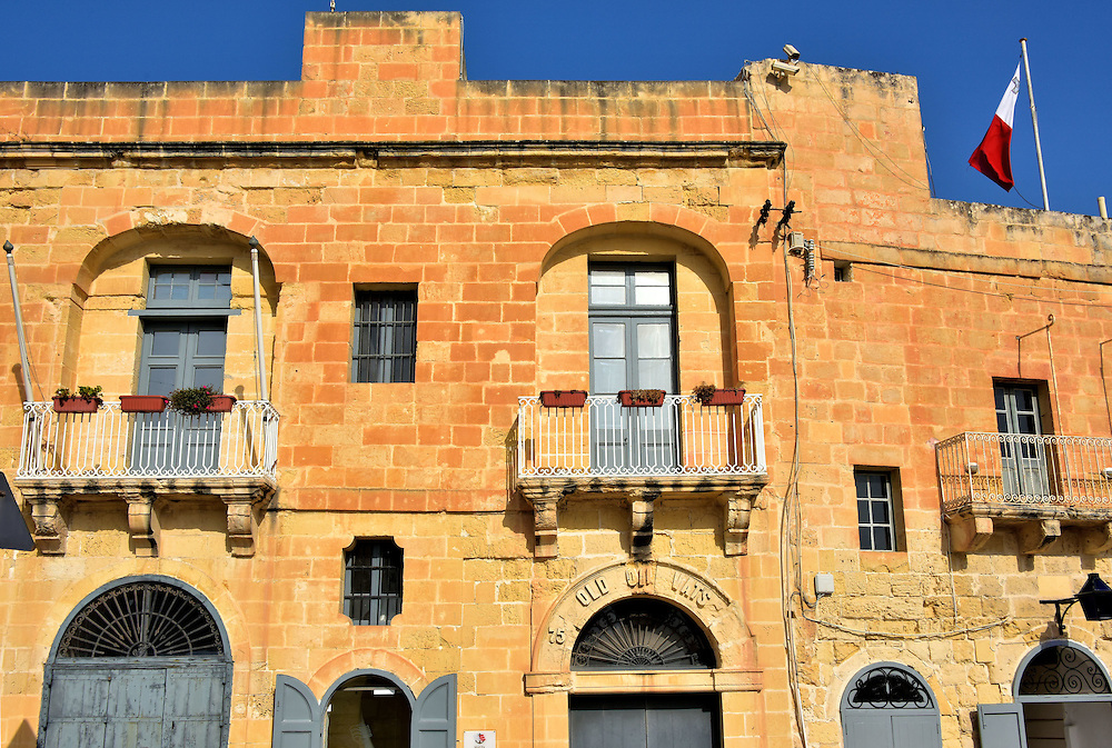 Old Power House in Floriana Near Valletta, Malta <br /> Most tourists to Valletta spend their time visiting the historic buildings inside the fortified upper levels.  But if you have some extra time, then walk the 300 foot promenade along the Valletta Waterfront.  These buildings were once warehouses for the knights. The color of the door signified the type of merchandise stored inside. An example is this Old Power House. It was an arsenal in the late 17th century, used to store vats of lamp fuel during the 1700s and later became a power station. Current plans are to incorporate it into the city&rsquo;s cruise terminal.