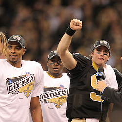Jan 24, 2010; New Orleans, LA, USA; New Orleans Saints quarterback Drew Brees (9) talks to Fox broadcaster Chris Myers as Jeremy Shockey (left) and Darren Sharper (center) and Reggie Bush (right) celebrate following a 31-28 overtime victory by the New Orleans Saints over the Minnesota Vikings in the 2010 NFC Championship game at the Louisiana Superdome. Mandatory Credit: Derick E. Hingle-US PRESSWIRE