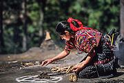 Chichicastenango: Shrine of Pascual Abaj (Sacrifice Stone). Sacrifice of a chicken to Huyup Tak'Ah, the Mayan Earth god.