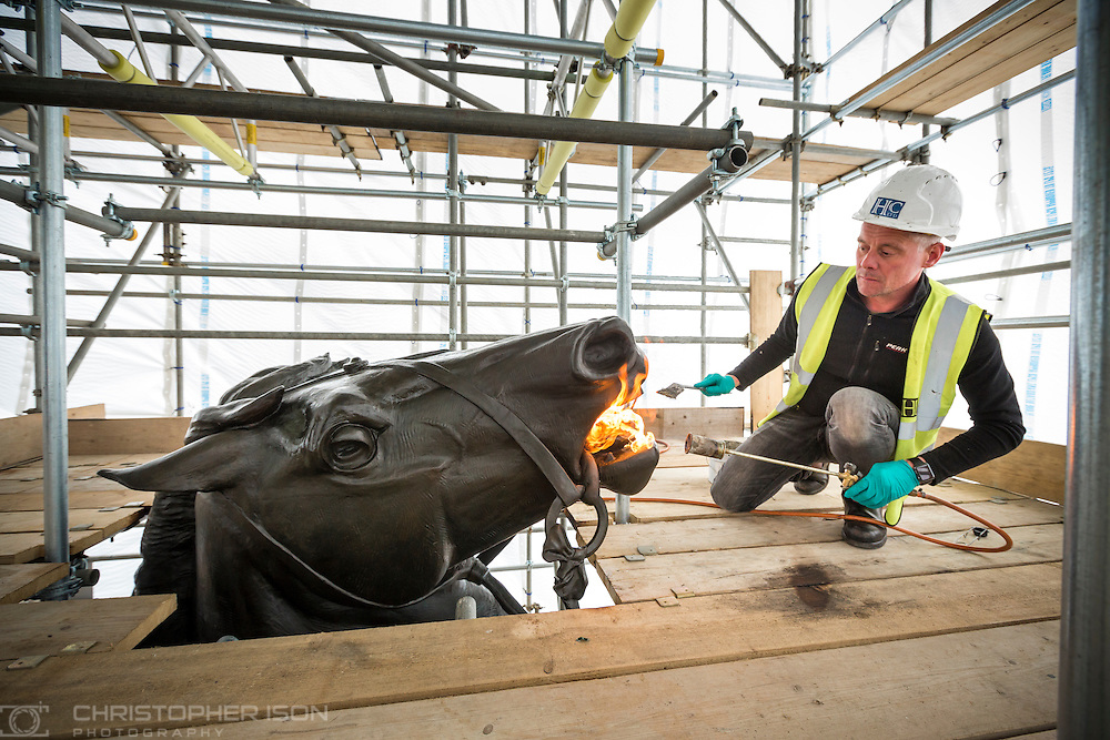 Conservation work being undertaken on the quadriga statue which stands on top of the Wellington Arch at Hyde Park Corner, London.<br /> Picture date: Thursday April 7, 2016.<br /> Photograph by Christopher Ison for English Heritage &copy;<br /> 07544044177<br /> chris@christopherison.com<br /> www.christopherison.com